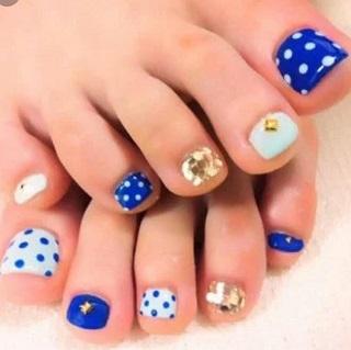 White, blue polka and gold design